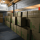 Moving boxes stacked in hall